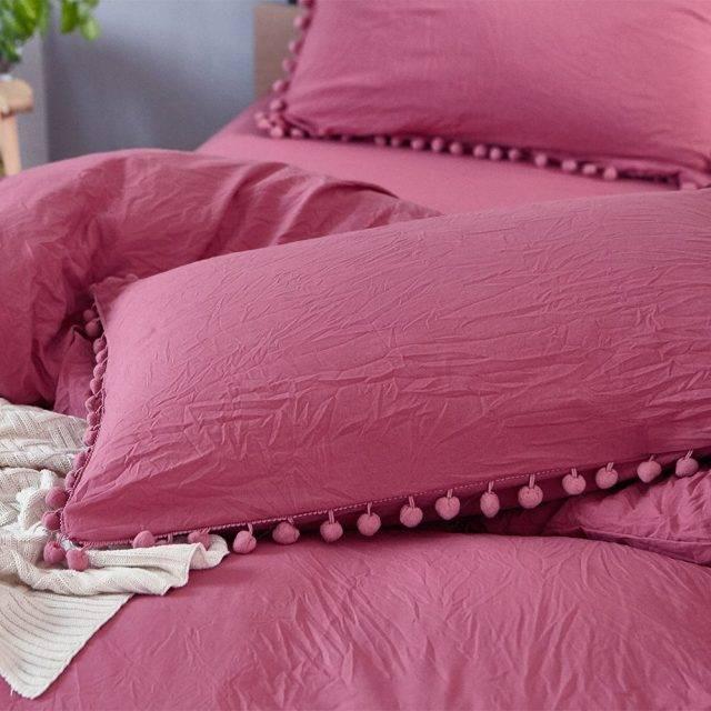 red pom pom pillow