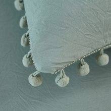 solid pastel soft pastel green pillows close up