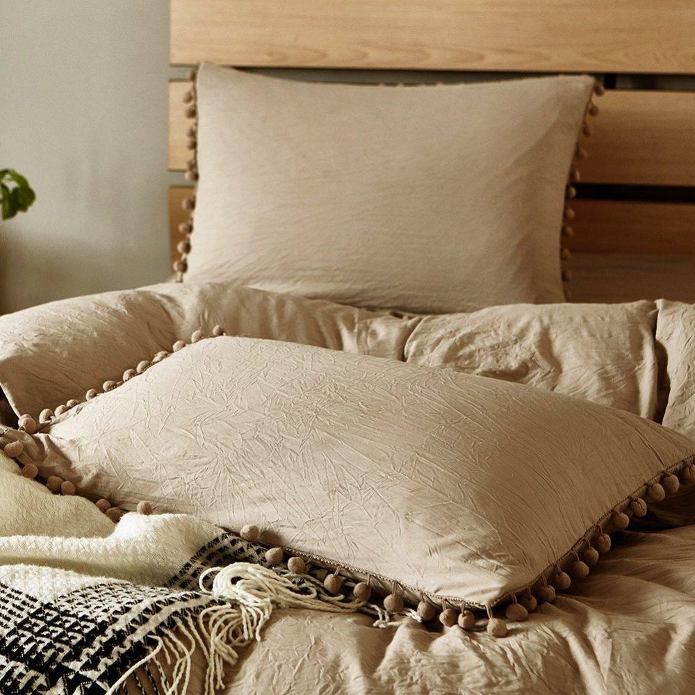 khaki pom pom pillows